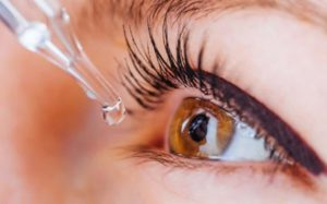 A person putting a homemade MSM eye drop to their eye