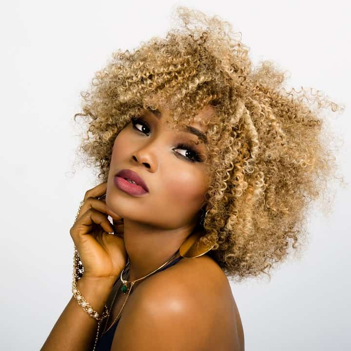 beautiful woman with short blond curly hair